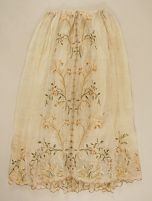 "This could easily be the under-petticoat of Tamsen's ensemble at the start of the story ""embroidered in a garden of gold."" Skirt (front view) Date: 1795–1805 Culture: French Medium: silk, linen Accession Number: 35.98.3"