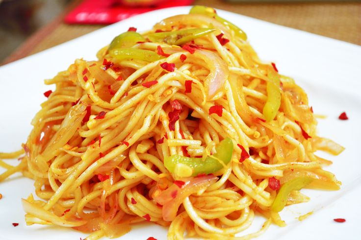 Spicy chilli garlic noodles is an awesome combination of flavours of ginger and red chillies. Make it quickly for a lazy weekend dinner and serve with mushroom chilli or vegetable Manchurian for a wholesome dinner meal. Recipe by Pooja.   http://ift.tt/2bPnsxa #Vegetarian #Recipes