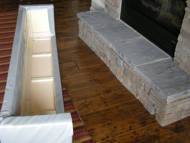 Fireplace Stone! This picture was about a fireplace cover pad so that it could be used it as an extra seat. However, I'm interested in the stone that is in front and in the actual fireplace! :)