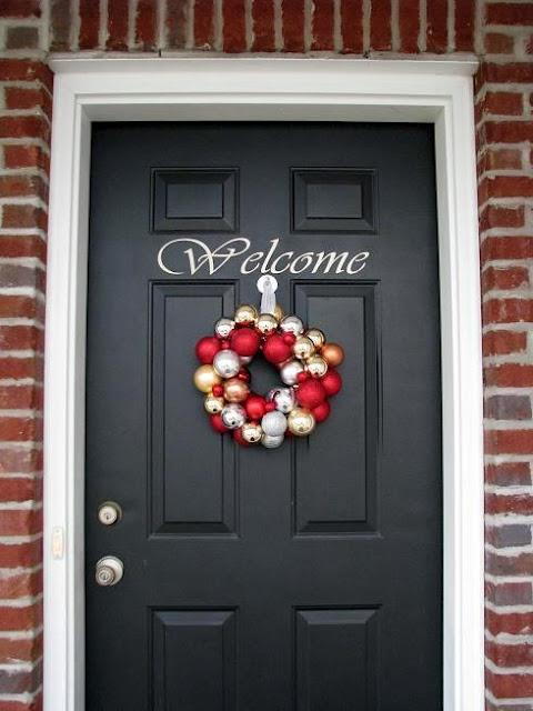 Paint front door charcoal to let door decor pop. hmmm... kinda like this idea.