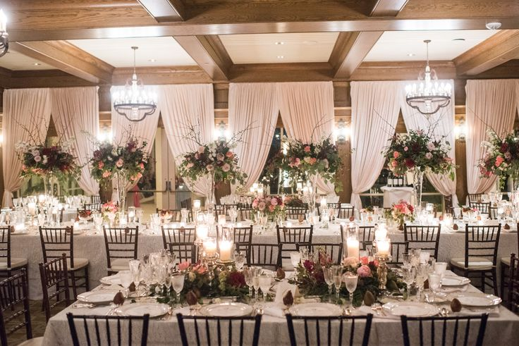 for a formal seated dinner,  table arrangements were a perfect combination of tall arrangements in trumpet vases on the head table, and low lush arrangements on the surrounding round tables.