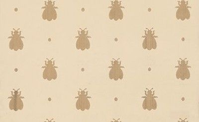 Bumble Bee (BP 516) - Farrow & Ball Wallpapers - Featuring an enchanting myriad of bumble bees and sprinkled with cheeky polka dots. Showing in metallic gold on sandy/beige water based paints - more colours are available. Please request a sample for true colour match.