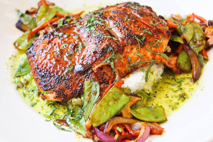 Thai Glazed Salmon! Pan seared and served with vegetables and white rice in a delicious Thai coconut cashew sauce! *Availability varies by location.