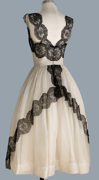 Cream Colored Vintage Wedding Dress With Black Lace Trim