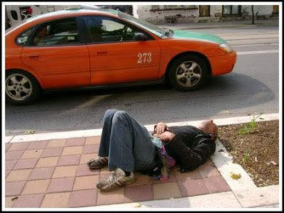 A person lying near a street in Toronto