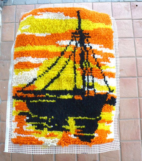 This listing is for a vintage sailboat latch hook wall hanging made in the 70s. The piece will need to be framed for hanging and the actual completed latch hook is 18 inches wide by 24 inches tall. Its in very good, clean condition without odor.
