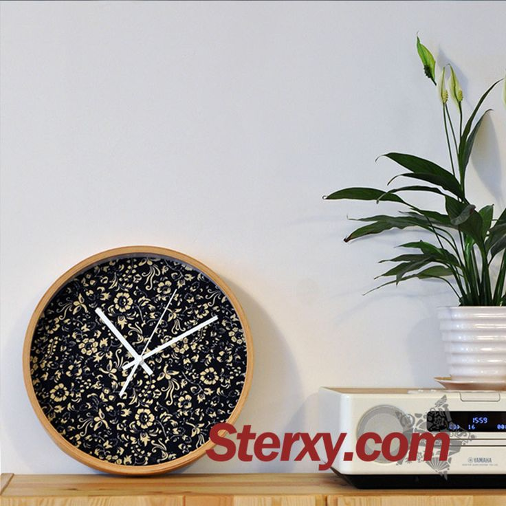 Featuring a beautiful daisy print in cobalt blue, the pattern is derived from Chinese porcelain. Completed with wood frame and glass cover, the white hands contrast brightly to show simplicity and elegance. #wallclock #classic #black