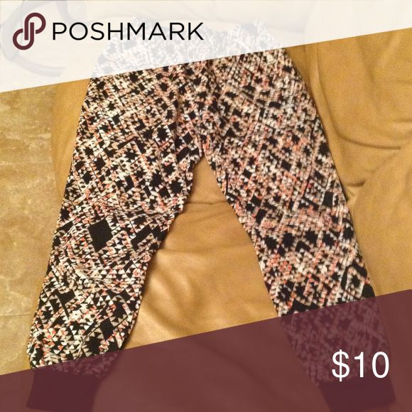 Jogger pants Hardly ever used black white pink tan triangle design jogger pants. ( LIKE NEW) Jeans Ankle & Cropped