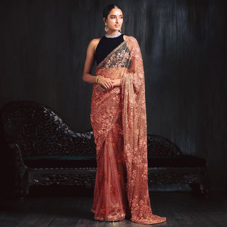 A peach tulle saree with placement encrustation