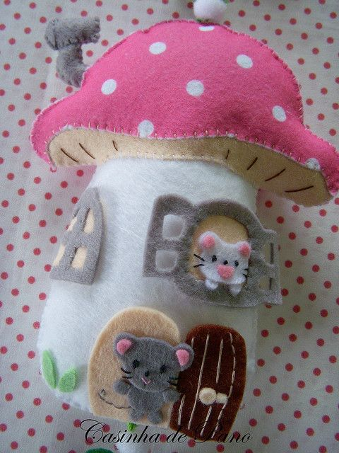 This is an adorable idea. Sewing together felt homes for small felt creatures. I think children would love this.