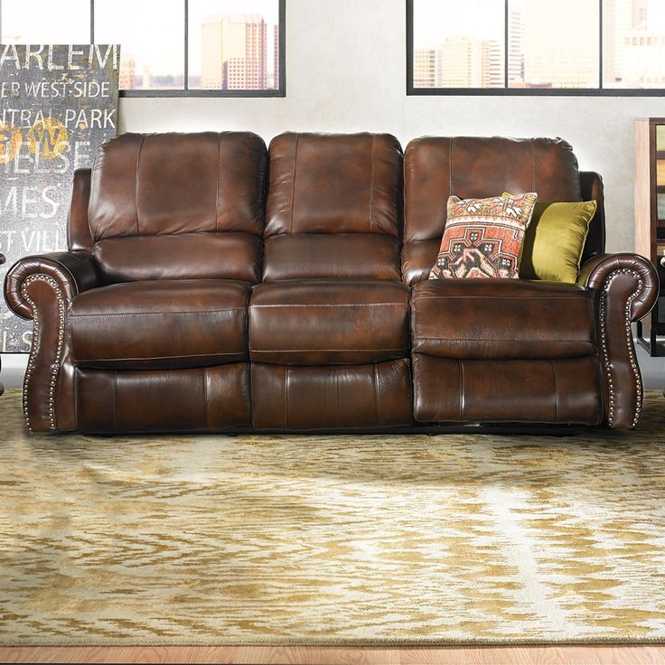 Perfect This Power Reclining Sofa Features Motorized Dual Reclining Seats In A  Gorgeous Brown Top Grain Leather With Nailhead Trim. Great Ideas