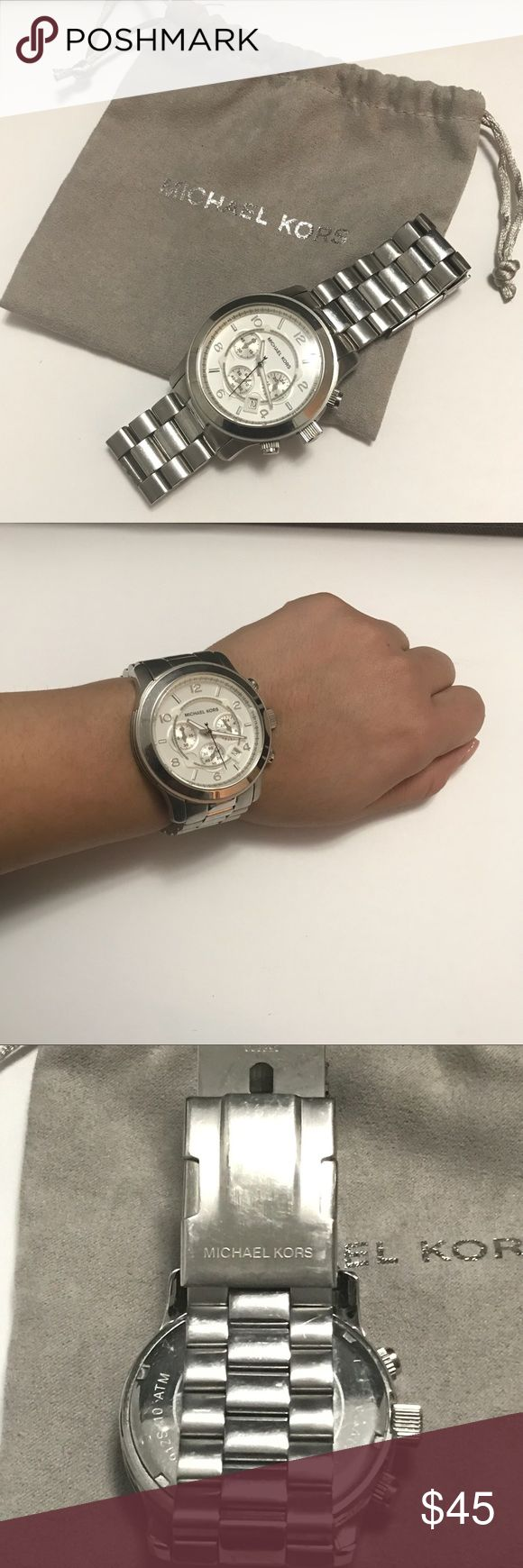 MK Women Silver Watch stainless steel One of the most popular style of MK women watches. It looks great on with a work, casual, or date night outfit. Light scratches. Requires battery.  Measurements Dial: 1.5in / 4cm Band: 0.75in / 2cm Diameter: 2.75in / 7cm Michael Kors Accessories Watches