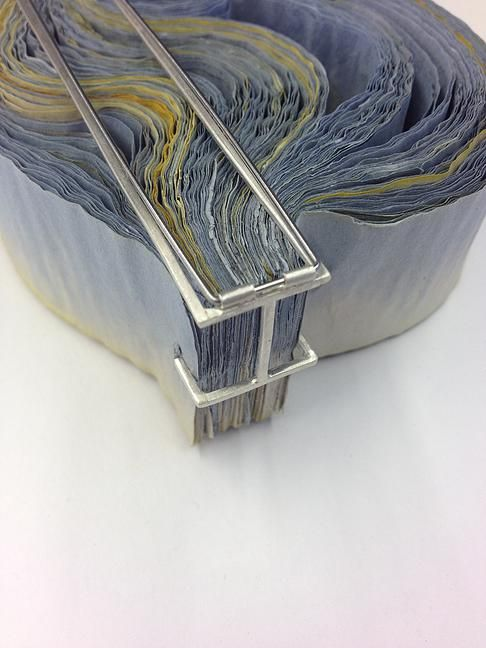 "Rachel Blair- reverse of ""overwhelmed"" ripple brooch -   white metal & ink stained paper"