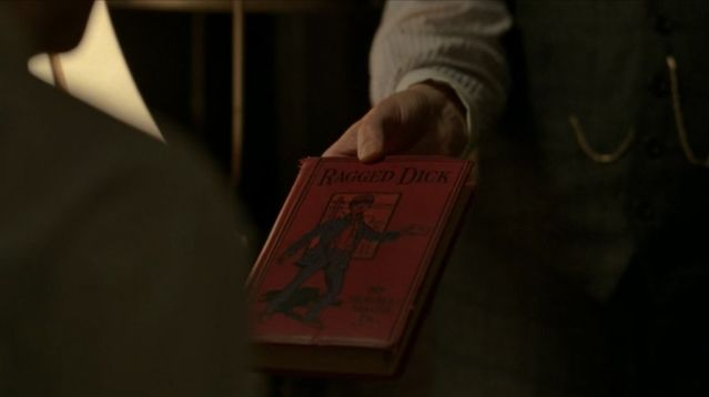 "Ragged Dick, Or, Street Life in New York with the Boot-blacks, by Horatio Alger - Boardwalk Empire Season 4 Episode 8 - ""The Old Ship of Zion"". This book was also featured prominently in Season 3 Episode 11, ""Two Imposters"""