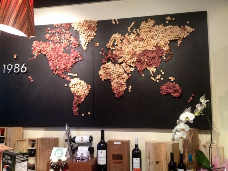 My local wine store made this with corks! [2048 x 1536] [OC] [greenland intensifies] The detail in topography was amazing! I'm pretty sure the red-dish colours indicate countries that produce wine...