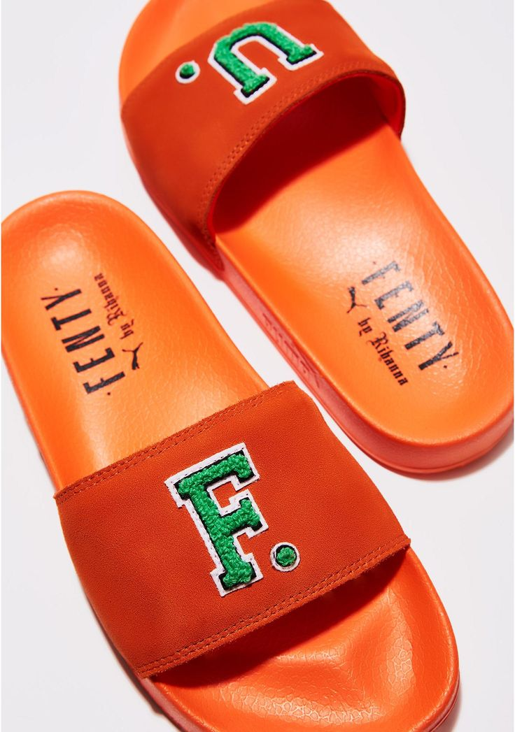 PUMA FENTY PUMA BY Rihanna Scarlet Ibis Leadcat FU Slides cuz you just want to slide right in. These slides have a suede strap featuring F and U patches on top and comfy af rubber soles.