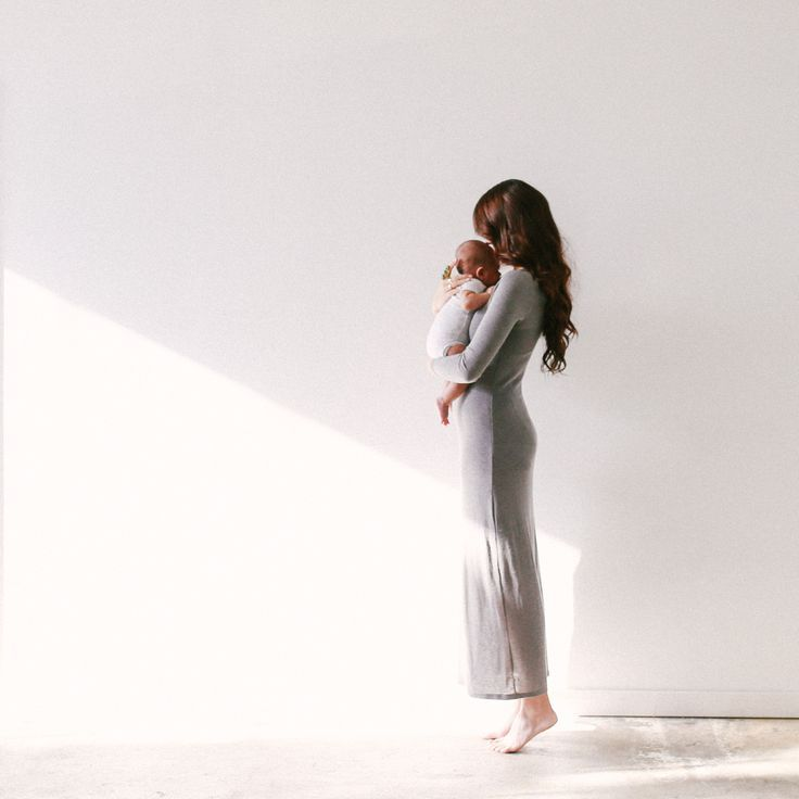 mandi nelson photography - Love the light filled space, her dress, the way she's on her toes, and the anonymity.: