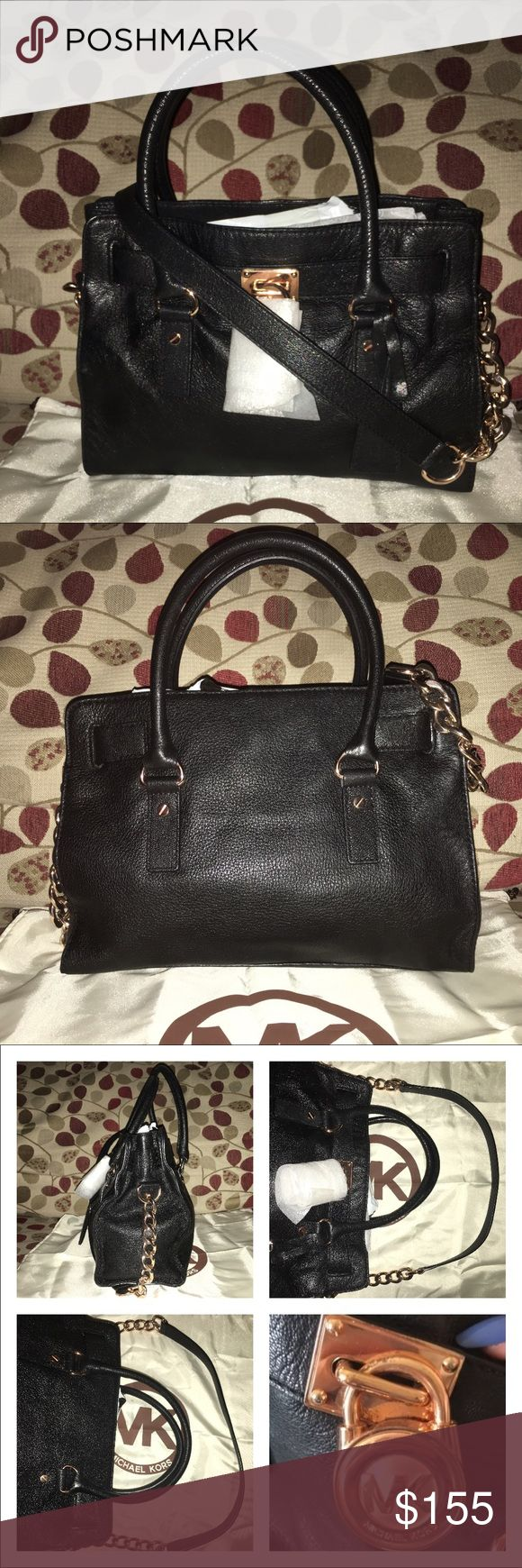 "Michael Kors E/W Hamilton Muchael Kirs E/W Black Pebbled Leather Hamilton w/ 🌹Rose Gold🌹 hardware! It has Logo lining, 1 zip, multiple zip pockets, key fob, strap is chain and leather for the option of wearing it in your shoulder drop is 18.5""! Bag closes by magnetic snap! Double rolled handle drop is 7"" bag measures 12.5 X 10 X 4 bag is in wonderful condition and clean, only issue is scratching on the plate wear the lick hangs, plz see pics! Dust bag included 🚫no trades price firm🚫 KORS…"