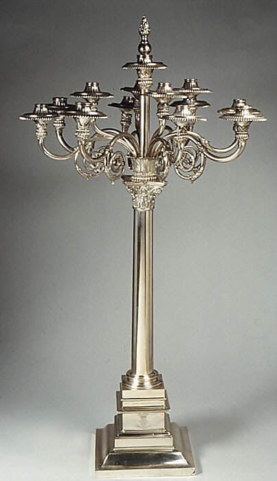 "1805-1806 British Twelve-light candelabrum at the Metropolitan Museum of Art, New York - From the curators' comments: ""This massive candelabra is based on a Roman triumphal column in Alexandria known as the column of Pompey. It bears the arms of Ernest Augustus, Duke of Cumberland, who became the colonel of the 15th Light Dragoons in 1802, which probably commissioned this candelabra as a gift."""