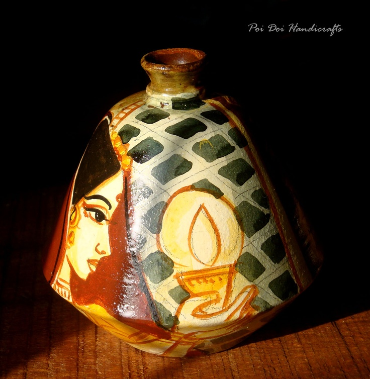 This pretty lady holding a earthen diya/lamp painted on a earthen pot is inspired by our Festival of Lights Diwali, when every house in India lights up a oil lamp.