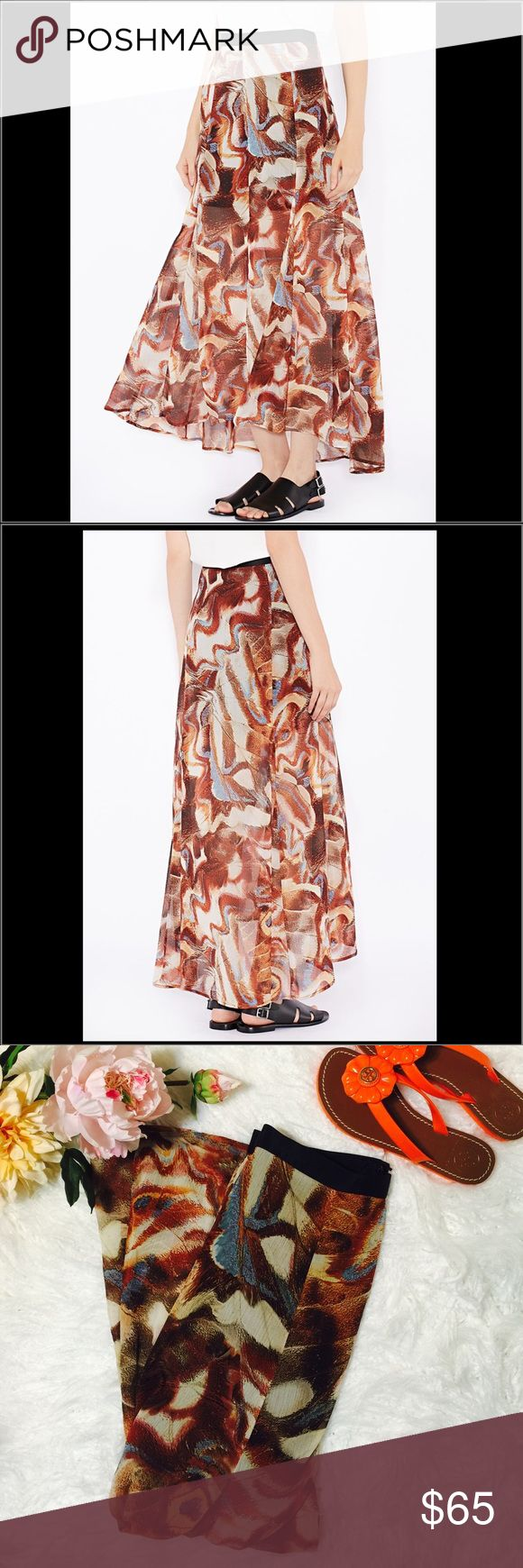 "❗️Price Drop❗️Top shop Brown Moth Wing Print Maxi S30-Think boho vibes in this moth print maxi skirt. Cut with a split front and longer hem to the back, this floaty, fluid shape drapes effortlessly. 100% Polyester. Flat across @ waist: 14"", Lenght: 39"". NWT Topshop Skirts Maxi"