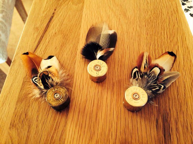 Shotgun cartridge and feather badge