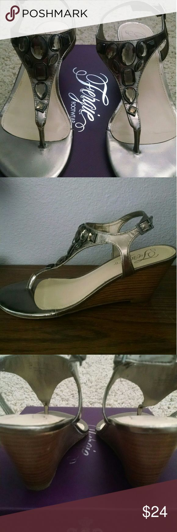 """Fergie Gem Embellished Wedge Sandal Pewter color, thong style wedge slingback sandal; neutral color goes with everything! Excellent condition, worn only a handful of times. Adjustable side buckle strap; heel height approx. 3""""; manmade upper and sole. Fergie Shoes Sandals"""