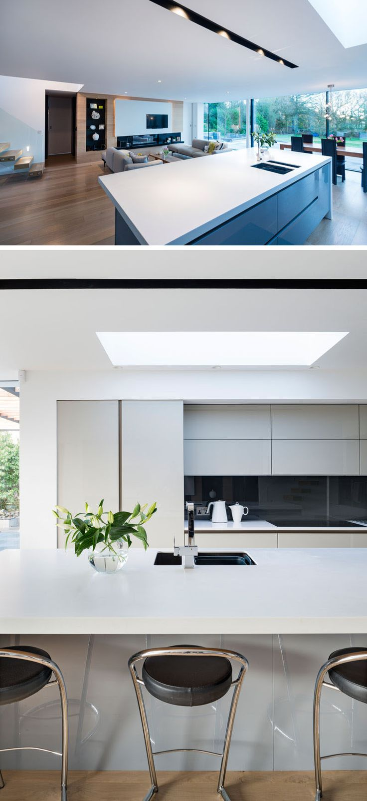 Hardware free minimalist grey cabinets and white countertops keep this kitchen looking sophisticated.