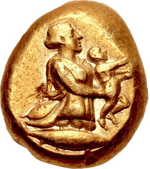 Rare Coin Showing The Myth of Erichthonios, C. 450-330 BCThis electrum stater is from the ancient city of Kyzikos (Cyzicus, map) in Mysia. It shows the Earth (Gaia) rising out of the ground, bearing in both hands the infant Erichthonios with a tunny...