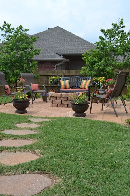 great firepit, stone walkway & patio. Good idea for concrete slab