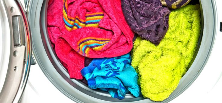Colored towels in washing machine | Trick to Removing Mildew Smell from Towels