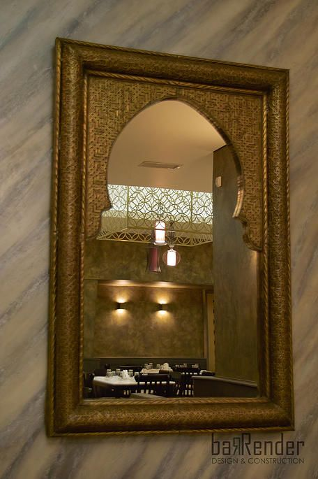 Arabesque wall-mounted mirror: Hand-crafted patterns on bronze - Barbalexis Oriental Restaurant