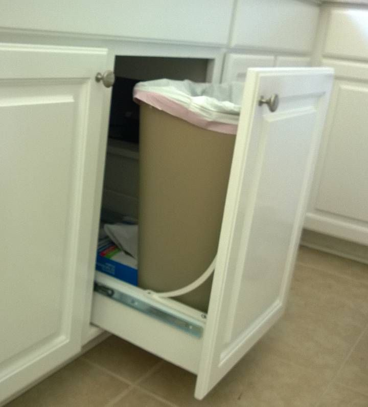 Pull out trash drawer. Not much space under kitchen sink. Less than 10\