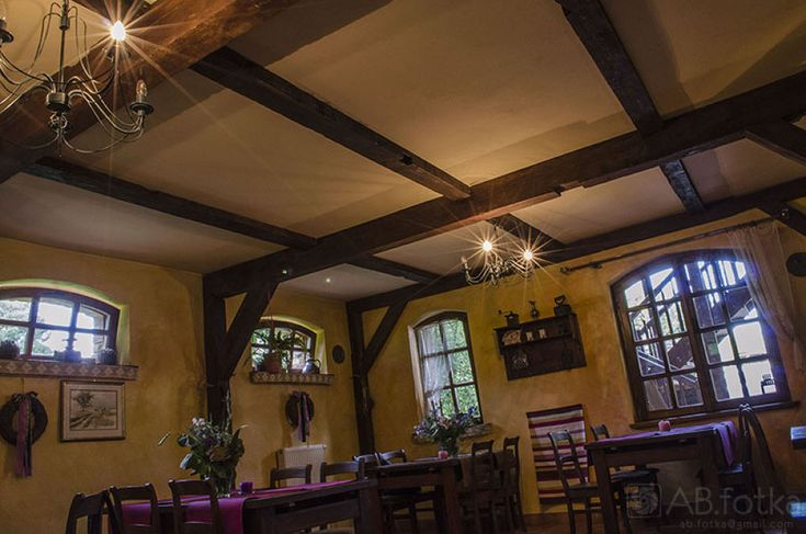 Inside of country restaurant by Adam Budziarek