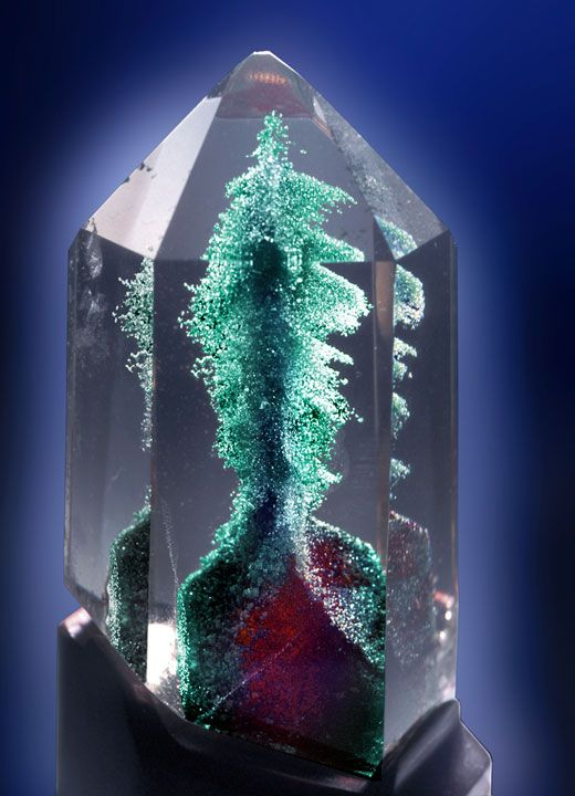 Quartz with phantom (probably a secondary copper mineral) Looks like an erupting volcano.