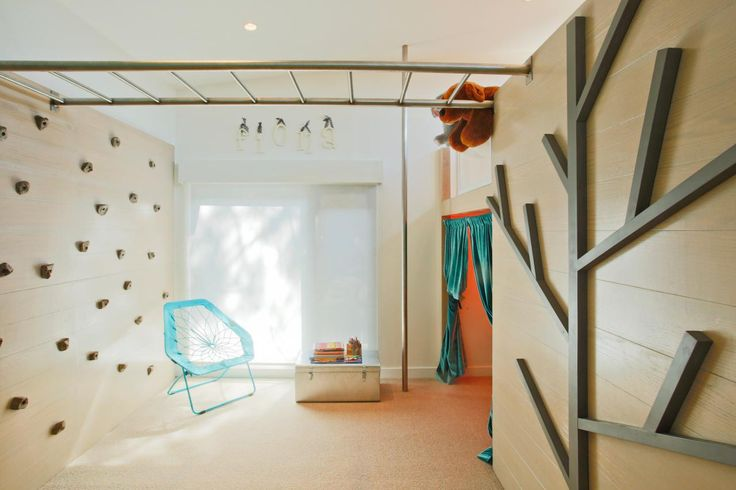 Host Jennie Garth created an activity space within her daughter Fiona's bedroom, complete with a rock cimbing wall and monkey bars, as seen on The Jennie Garth Project.