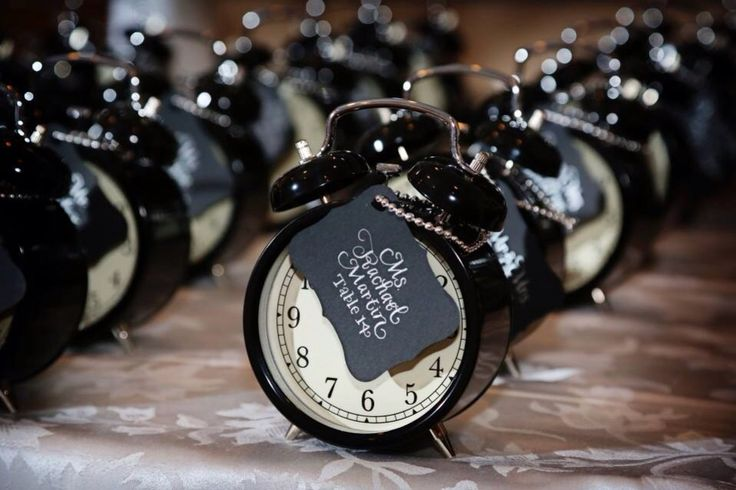 Seating cards attached to cool lil' clocks for a New Year's Eve wedding!  {More inspiration at www.CalligraphyBoston.com}