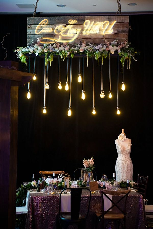 Hanging Edison lights and romantic wedding details