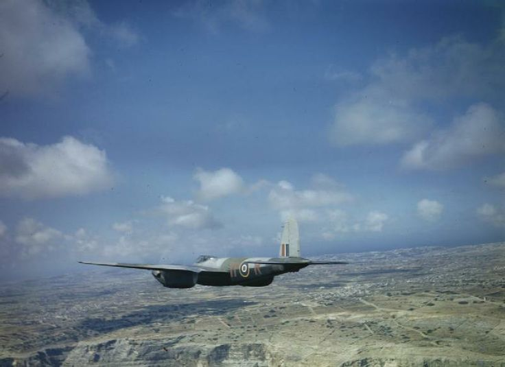 Mosquito Mark II, DZ230 'YP-A', piloted by Wing Commander P G Wykeham-Barnes, Commanding Officer of No. 23 Squadron RAF, based at Luqa, flying past Filfla Island south-west of Malta.  JUNE 1943