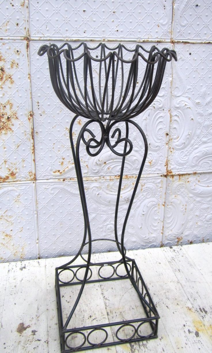 tall wrought iron plant classical stand gate photo