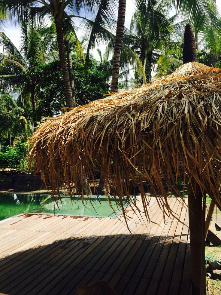 Bamboo an Alang-Alang umbrella at the tropical pool at Captain Coconuts Gili Air