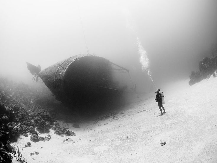 Picture of a diver in front of the Hilma Hooker shipwreck off Bonaire
