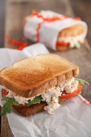 Shrimp Salad Sandwich 1 pound cooked shrimp, peeled and de-veined   3 hard-boiled eggs, finely chopped   3 celery stalks, minced   1/2 cup mayonnaise   Dash onion salt   Salt and pepper   Seasoning salt   Celery salt   8 slices your choice bread, toasted   Lettuce and tomato slices, optional