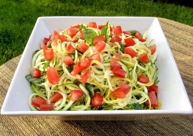 This Balsamic Zoodle Bowl combines summer squash noodles with fresh basil and marinated tomatoes.
