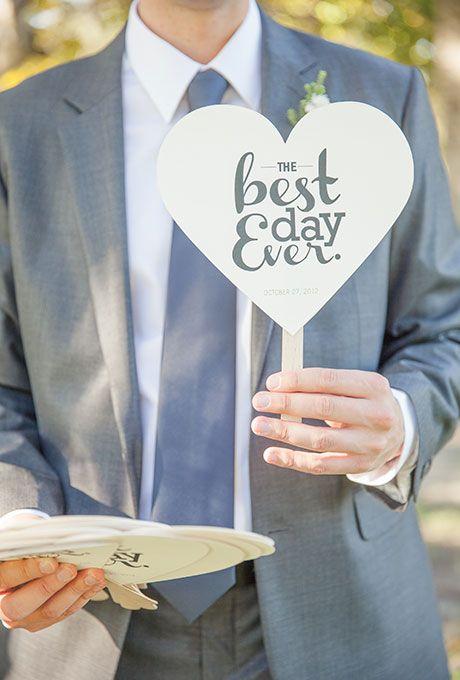 A DIY heart-shaped wedding ceremony program fan | Brides.com