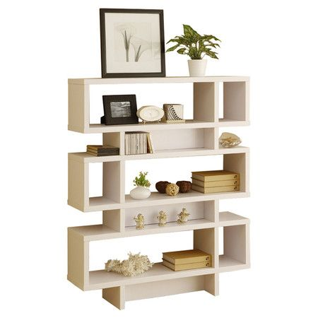 Three-tier geometric bookcase in white.  Product: BookcaseConstruction Material: MDF and veneersColo...