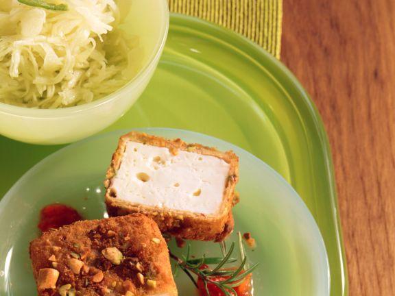Panierter Schafskäse mit Tomatensauce ist ein Rezept mit frischen Zutaten aus der Kategorie Käse. Probieren Sie dieses und weitere Rezepte von EAT SMARTER!