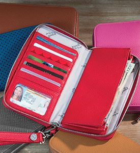RED!! $48 for a wallet that lasts FOREVER!  Add a wristlet strap for $8 and turn it into the perfect clutch! It even fits my iphone 6+  www.mythirtyone.com/laurievanvleet
