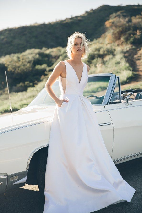 Folavere, The newly-launched, direct-to-consumer line lets customers try on samples of their affordable wedding dresses, like the architectural H. Golightly for $45, which will then be reimbursed after purchase.