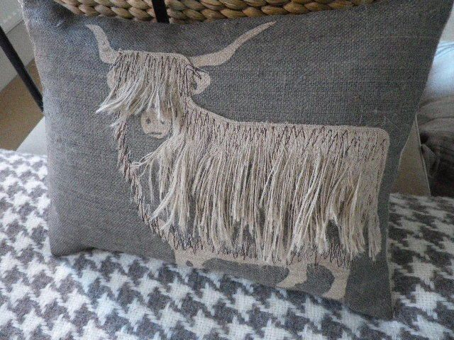 hand printed and appliqued shaggy highland cow cushion